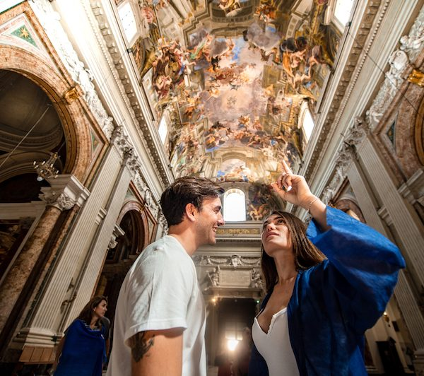 Couple exploring life of St. Ignacius on the ceiling of St. Ignatius of Loyola in Rome