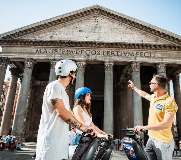 Rome tourist guide showing Pantheon to a couple on segway