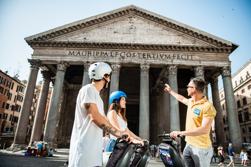 Rome guide showing Pantheon to a couple on segway