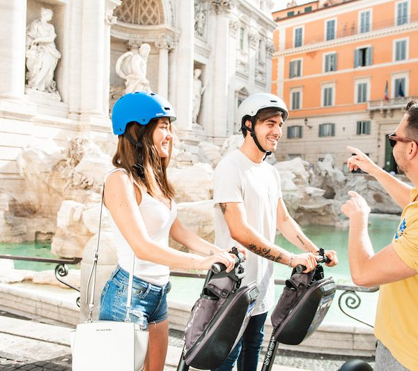The segway guide is explaining details of the Trevi Fountain during the Segway Tour in Rome