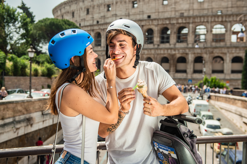 Couple eating ice cream infront of Colosseum during the Segway Tour in Rome