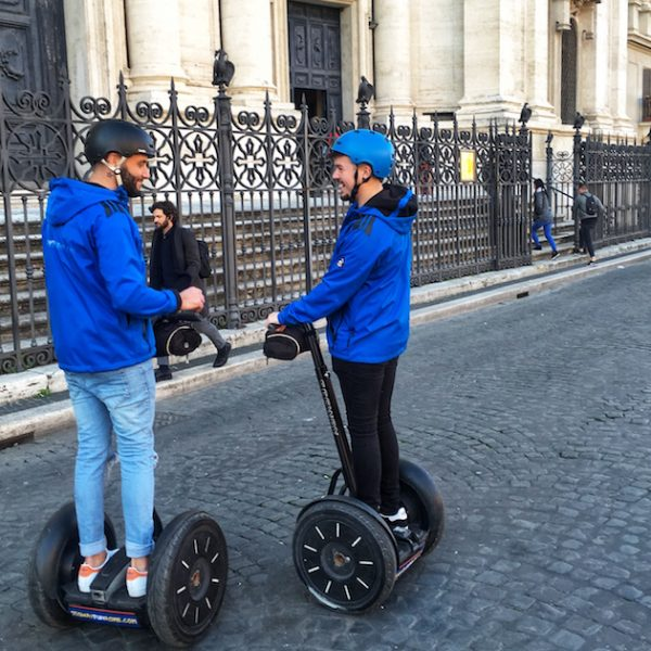 Gay couple at piazza Navona in Rome during Segway Tour