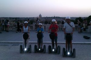 Family on Segway Taking picture from Pincio Terrace in Rome