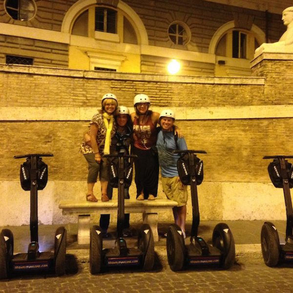 Family on segway taking picture from Piazza del Popolo in Rome