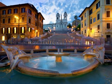 Bernini's fountain at piazza di Spagna with the Church of St, Trinity