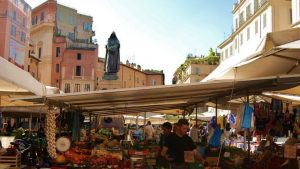 Fruit market at the Campo de` Fiori with statue of Giordano Bruno in the middle