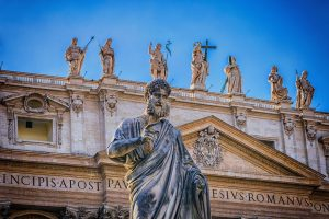 Statue of St. Peter`s on the colonnade of the basilica of St. Peter`s in Rome
