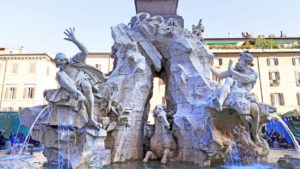 Statues representing the rivers from the Fountain of Four Rivers in Piazza Navona in Rome