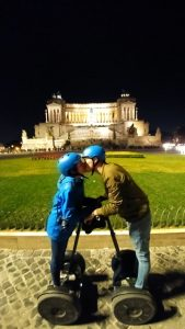 A kiss on segway in front of the Vittoriano in Rome at night