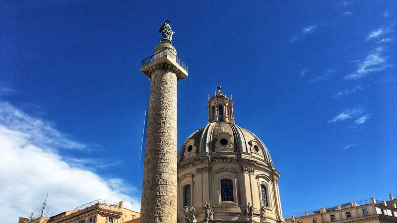 Traian column in Roman Forums in Rome with St. Peter in bronze on the top