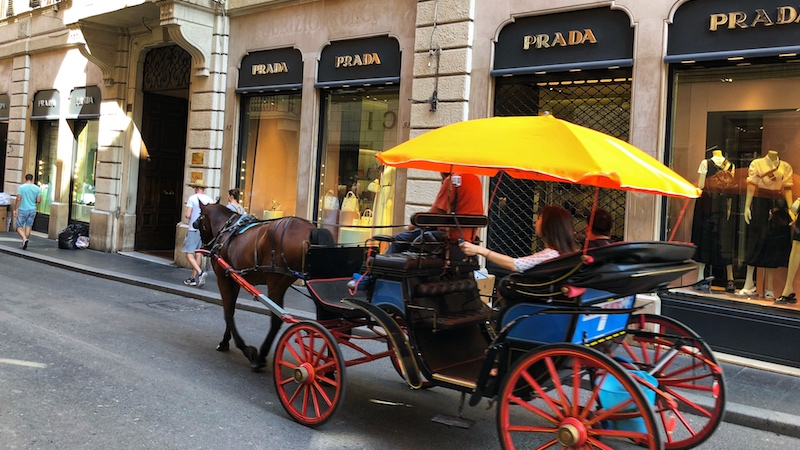 A horse carriage in via Condotti in Rome