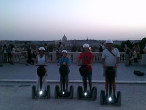Family on Segways taking picture on Pincio Hill in Rome