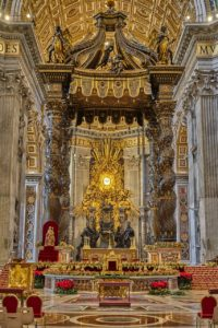 Interior of St. Peter's Basilica in Vatican City. Baldacchino stands above the thumb of St. Peter