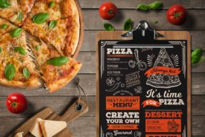 Pizza Margherita on a wooden table with a Roman restaurant menu and tomatoes and cheese