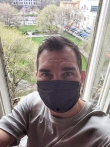 Man in the anti coronavirus mask at home in Rome
